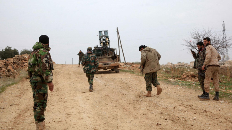 Syrian government forces hold a position in the village of Ain al-Beida in the countryside of Al-Bab in the eastern part of Syrian northern Aleppo province after taking control of the area from Islamist jihadists on January 13, 2016. Eastern parts of Aleppo province are held by the Islamic State jihadist group, and the west is held by opposition groups ranging from US-backed rebels to Al-Nusra. / AFP / GEORGE OURFALIAN