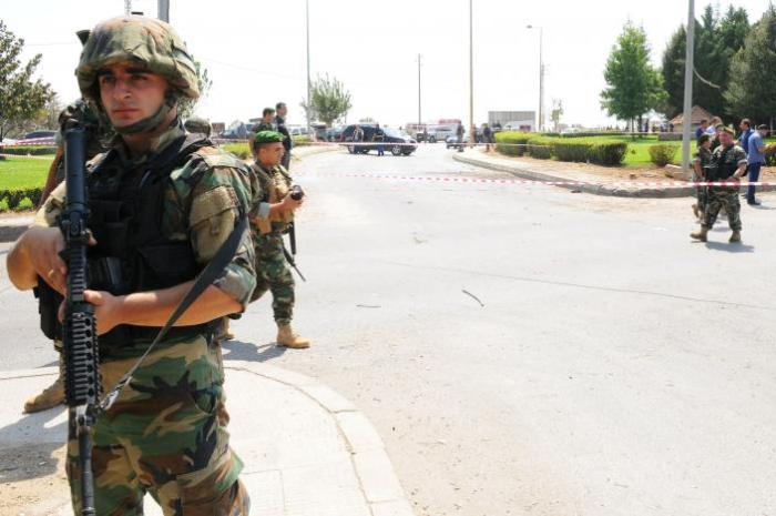 Lebanese army soldiers secure the area at the site of a bomb blast near the city of Zahle